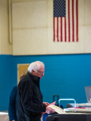Former Democratic presidential candidate Sen. Bernie Sanders, I-VT, casts his ballot at the Robert Miller Community and Recreation Center in Burlington on Tuesday, November 8, 2016.