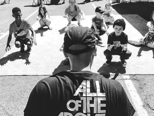 """Kids learn hip hop from """"Young Yi"""" of All of the Above Hip Hop Academy at the East Lansing Art Festival."""