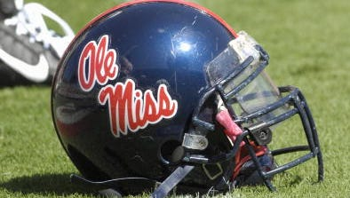 Ole Miss helmets rest on the ground before a game at Georgia in 2007.