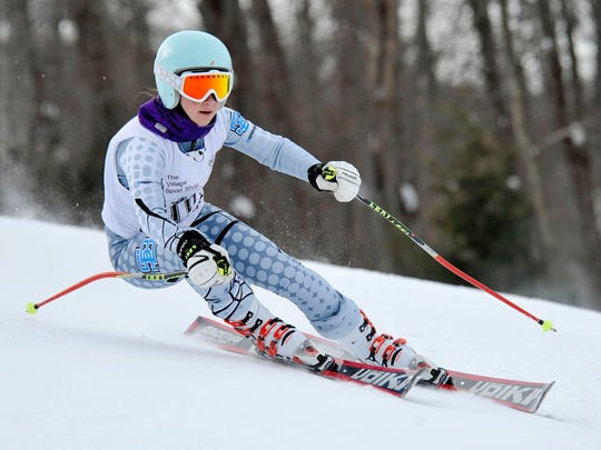 South Burlington's Madi Grabowski competes in the first of two giant slalom runs at Lyndon's annual ski carnival at Burke Mountain on Friday.