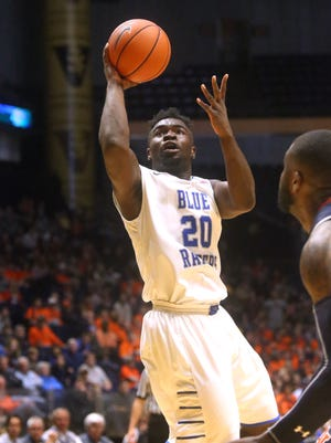 MTSU's Giddy Potts (20) goes up for a shot as Auburn's Cinmeon Bowers (5) moves in to guard Potts, on Saturday, Dec. 12, 2015, at Bridgestone Arena in Nashville.