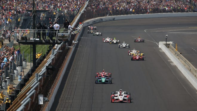 Juan Pablo Montoya takes the checkered flag, winning his second Indy 500 with a .1 second margin of victory over teammate Will Power in the 99th running of the Indianapolis 500 at the Indianapolis Motor Speedway on Sunday, May 24, 2015. Finishing behind them were Charlie Kimball, Scott Dixon, Graham Rahal, Marco Andretti and Helio Castroneves.