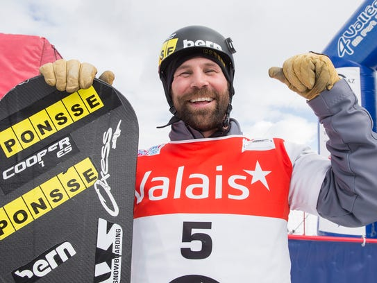 Nick Baumgartner from the U.S. poses after the men's Snowboard Cross World Cup, in Veysonnaz, Switzerland, March 6, 2016.