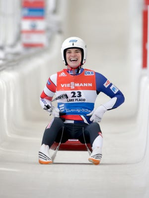 Summer Britcher, of the United States, celebrates her third place finish in the women's luge World Cup race on Saturday, Dec. 5, 2015, in Lake Placid, N.Y.