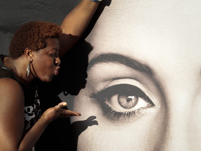 Dayana Maryland from Detroit blows a kiss at an Adele