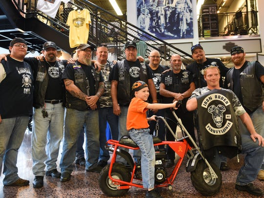 Lucas Steigelman, 7, poses for a picture with the 2nd Amendment Lebanon County chapter of the Iron Order Motorcycle Club after they presented a minibike to Steigelman on Thursday, Sept. 22, 2016, at Iron Valley Harley-Davidson. Steigelman was diagnosed with leukemia in January.