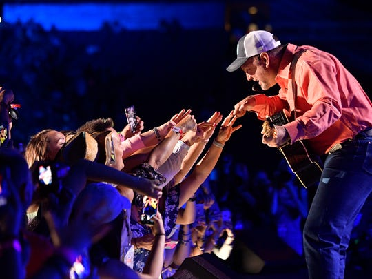 Garth Brooks interacts with the crowd as he performs during the CMA Music Festival on June 8, 2017, at Nissan Stadium in Nashville.