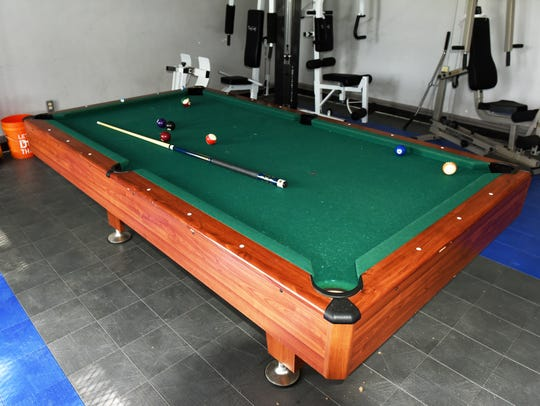 A new pool table sits in the gymnasium area at the