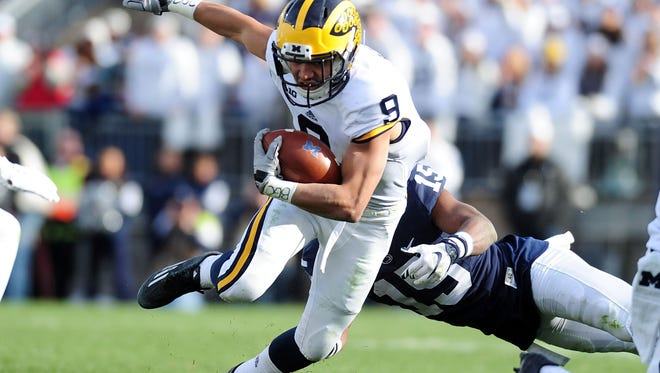Michigan's Grant Perry runs with the ball during the game against Penn State on Saturday.