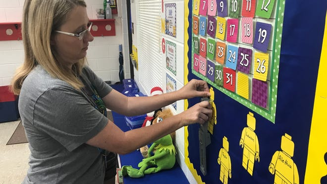 Heather Awbrey, who teaches second grade at Abilene Christian School, works on decorating her classroom with LEGO figurines while preparing for students to return Thursday, Aug. 17.