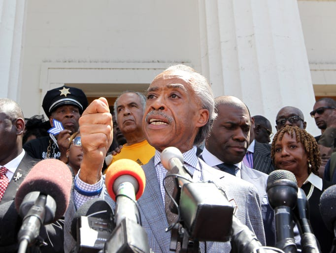 Rev. Al Sharpton makes powerful remarks to reporters on the steps of the Old Courthouse in St. Louis on August 12, 2014.