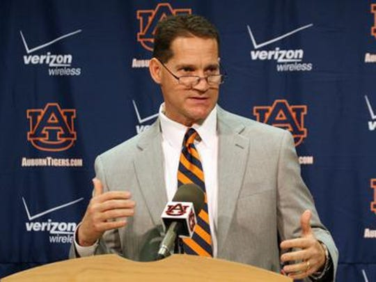 Former Iowa State coach Gene Chizik answers questions when he was introduced as the new coach at Auburn.