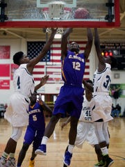 Camden's Deaquan Williams (12) goes for a layup against Atlantic City Saturday, Feb. 13 at the Cherry Hill East Invitational. Final score: Camden 65, Atlantic City 58.