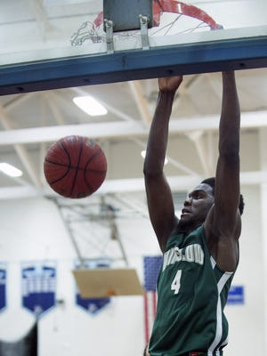 Winslow Township senior forward Manny Lowe delivers a two-handed dunk during the second half of Tuesday's South Jersey Group 3 final against Highland.