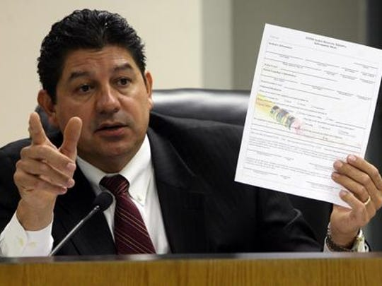 """Then-EPISD Superintendent Lorenzo García holds a """"contract"""" that students who failed a portion of the TAKS test were going to be required to sign along with their parents in order to walk during their graduations. The contract enrolled the students in the EPISD Senior Recovery Initiative, which included TAKS tutoring and retesting."""
