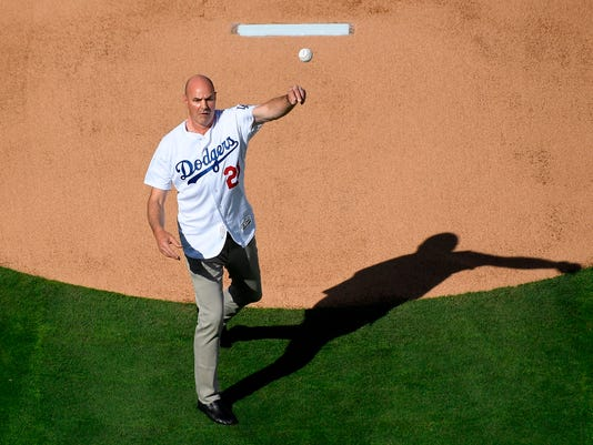 Former Los Angeles Dodgers' Kirk Gibson throws out the ceremonial first pitch prior to an opening day baseball game between the Dodgers and the San Francisco Giants, Thursday, March 29, 2018, in Los Angeles. (AP Photo/Mark J. Terrill)