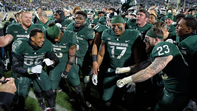 Michigan State Spartans players celebrate the win vs. Penn State.