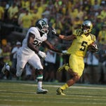 MSU safety RJ Williamson unsuccessfully tries to corral Oregon wide receiver Devon Allen during last season's game in Eugene, Ore. It was a rough day for Williamson and a loss that, for a while, took MSU off the national radar.