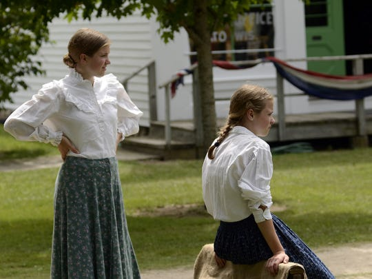 """Adults and children participate in the various events and activities comprising the """"Village Fair"""" at Pinecrest Historical Village on Saturday, Aug 10, 2013, in Manitowoc. Among the attractions there were Charlotte Stewart, who played """"Miss Beadle"""" on Little House on the Prairie, games and races typical to the 1870's era, food, and much more. Matthew Apgar/HTR Media"""