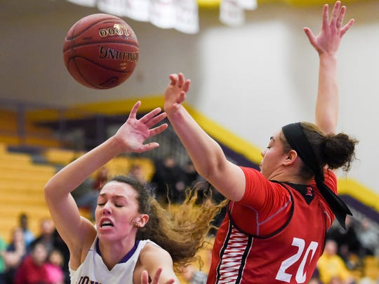 East's Justice Ross (20) blocks the shot of Johnston's Taryn Knuth (44) on Tuesday, Feb. 7, 2017, during a basketball game between the East Scarlets and the Johnston Dragons at Johnston High School.