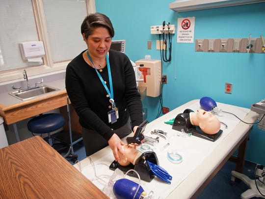 Dr. Maria Carmen Diaz, the medical director of simulation at the Nemours Institute of Clinical Excellence, shows off some of the simulation tools used to better train staff with responding to emergencies.