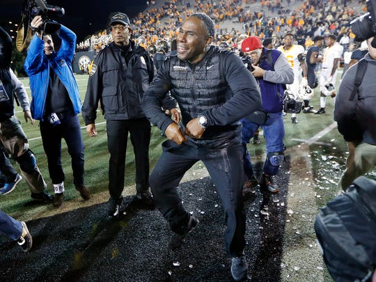 Vanderbilt head coach Derek Mason dances on the field after defeating Tennessee in an NCAA college football game Saturday, Nov. 24, 2018, in Nashville, Tenn. (AP Photo/Mark Humphrey)