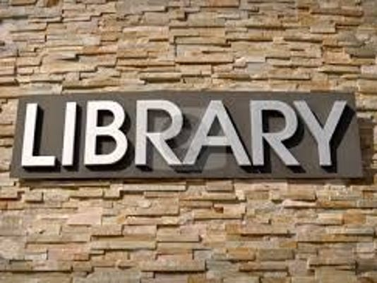 635766170663975372-Library-sign