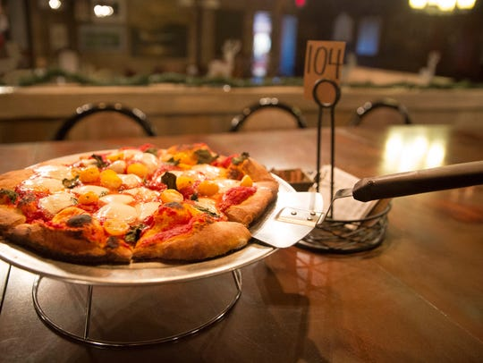 Executive Chef Matt Burns cooks up pizzas at Elm Street