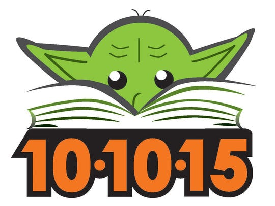 "Yoda is nose deep in a book in one of the two ""Star"