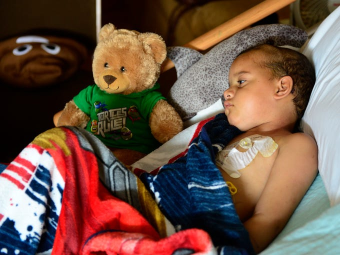 Tae Smith, 5, rests at a hospice center in Sandusky