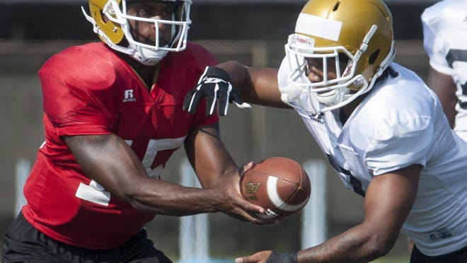 Alabama State University quarterback Daniel Duhart hands off to Khalid Thomas at football practice on the ASU campus in Montgomery, Ala. on Saturday morning August 15, 2015.