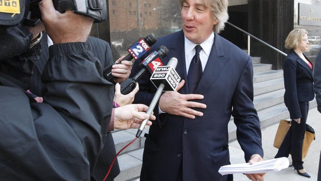 Lawyer and ex-candidate Geoffrey Fieger takes questions outside the federal courthouse in Detroit.