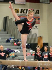 Canton's Stephanie Cox performs on balance beam at Saturday's regionals. She finished second in D1 in the event.