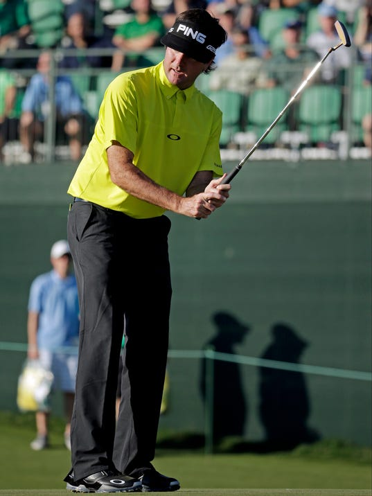 Bubba Watson misses a birdie putt on the 17th hole during the first round of the Masters golf tournament Thursday, April 10, 2014, in Augusta, Ga. (AP Photo/Chris Carlson)