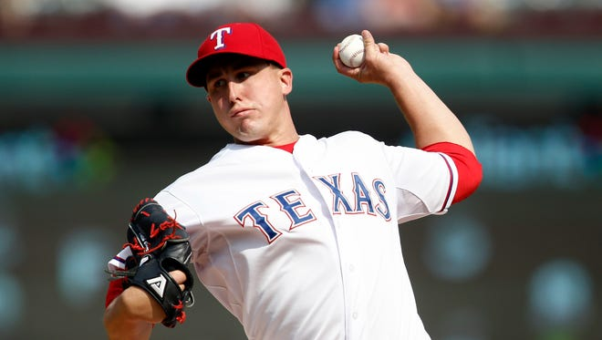 Rangers starting pitcher Derek Holland delivers a pitch to the Baltimore Orioles during the seventh inning of a ballgame at Globe Life Park in Arlington.