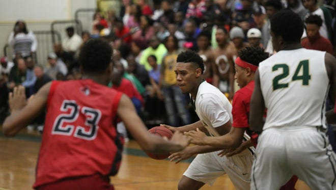 Lincoln's Kyle Kincey scored 20 points in a 57-54 win over Creekside on Friday in the Region 1-7A final. The win lifted the Trojans to the state tournament for the first time in school history.