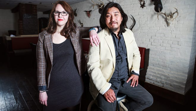 Milkwood chef Edward Lee and general manager Stacie Stewart inside the dining area of their downtown restaurant.