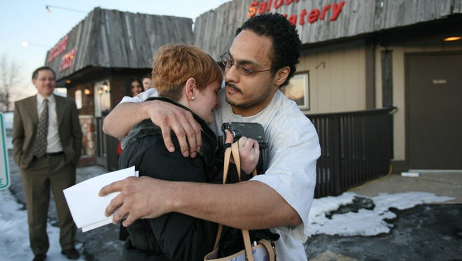 Chaunte Ott hugs his sister, Tami Ott, in front of the Hitching Post Restaurant in Portage after he was released from Columbia Correctional Institution in 2009. The city settled a wrongful conviction suit for $6.5 million with Ott.
