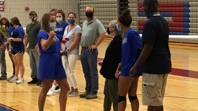 Seaman volleyball coach Tatiana Schafer, left, greets Camryn Turner and her parents during last Tuesday's Senior Night festivities.