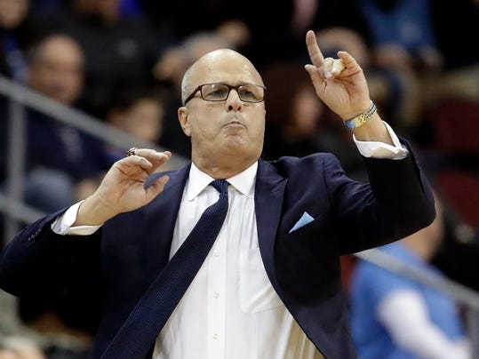 Fairleigh Dickinson head coach Greg Herenda talks to his team during the first half of an NCAA college basketball game against Seton Hall, Friday, Nov. 10, 2017, in Newark, N.J. Seton Hall won 90-68. (AP Photo/Julio Cortez)