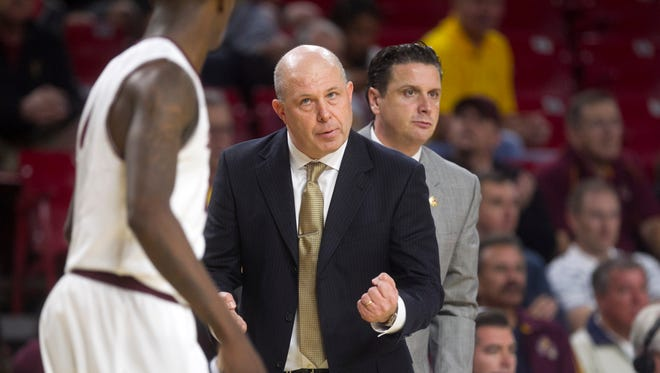 ASU head coach Herb Sendek talks to ASU's Willie Atwood during second half of the men's college basketball game on Saturday, Dec. 13, 2014, at Wells Fargo Arena in Tempe. ASU won the game 81-74.