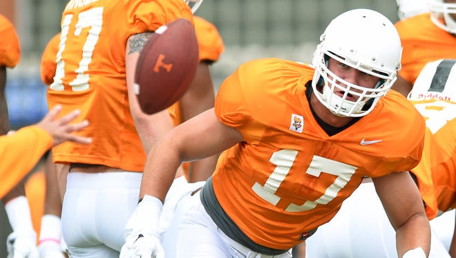 Tennessee linebacker Dillon Bates dives for a ball during practice Aug. 7, 2015, in Knoxville, Tenn.