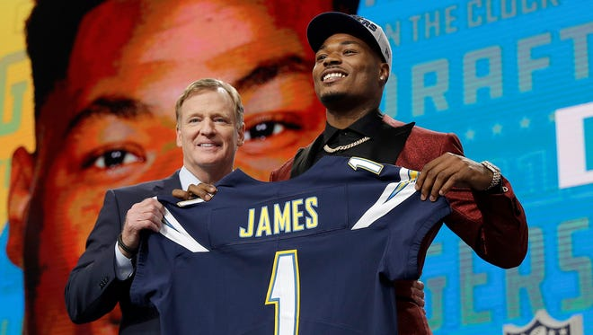 Commissioner Roger Goodell, left, presents Florida State's Derwin James with his Los Angeles Chargers jersey during the first round of the NFL football draft, Thursday, April 26, 2018, in Arlington, Texas.