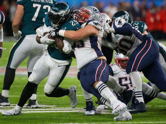 Eagles running back LeGarrette Blount fights his way through the Patriots defense Sunday at US Bank Stadium