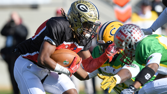 Greer's Qua White, left, returns a kickoff for South Carolina during its 55-24 loss Saturday in the 81st Shrine Bowl of the Carolinas at Gibbs Stadium in Spartanburg.