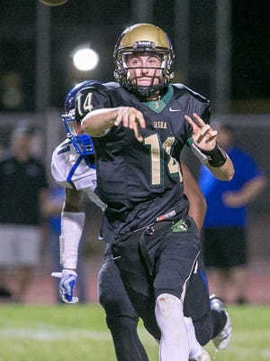 Chandler Basha quarterback Ryan Kelley passes the ball during their boys high school football game against Chandler on Friday, October 2, 2015. #hsfb