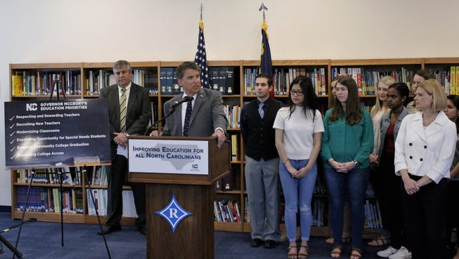 North Carolina Gov. Pat McCrory, flanked by students and a state official, discusses his education proposals for the state budget Tuesday at Ragsdale High School.