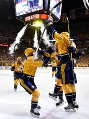 Predators center Colton Sissons, right, celebrates his goal against the Ducks  during the third period of Game 6 in the Western Conference finals May 22, 2017.