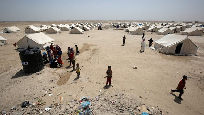 Iraqis displaced from the city of Fallujah are seen at a newly opened camp where hundreds of refugees are taking shelter on June 27, 2016, south of Fallujah.
