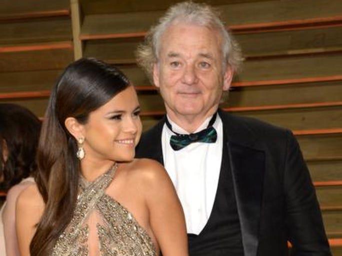 Bill Murray photobombs Selena Gomez at the 2014 Vanity Fair Oscar Party.